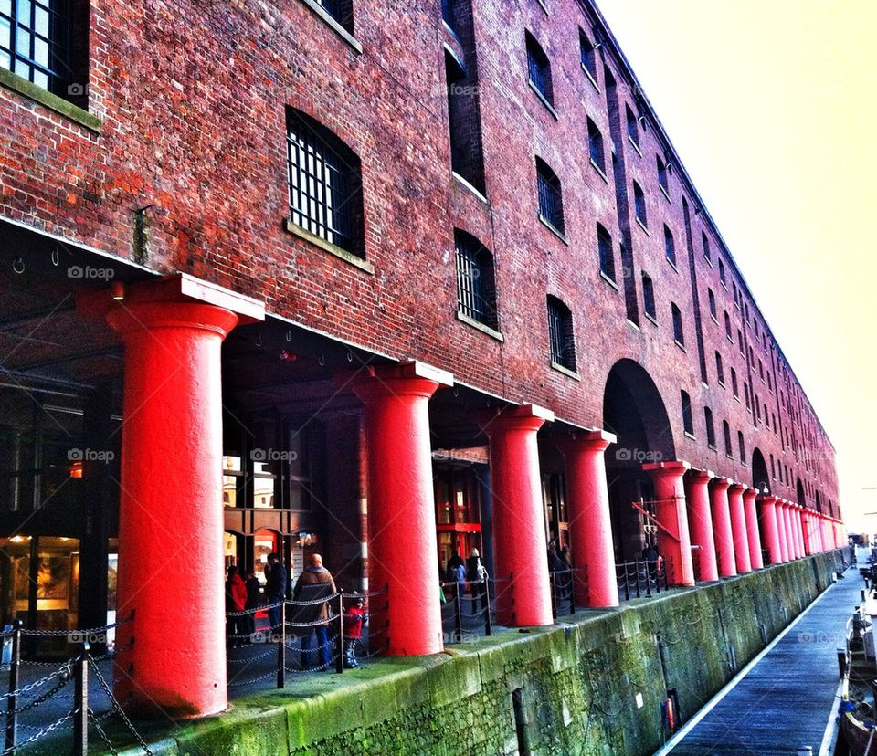 red buildings warehouse pillars by jeanello