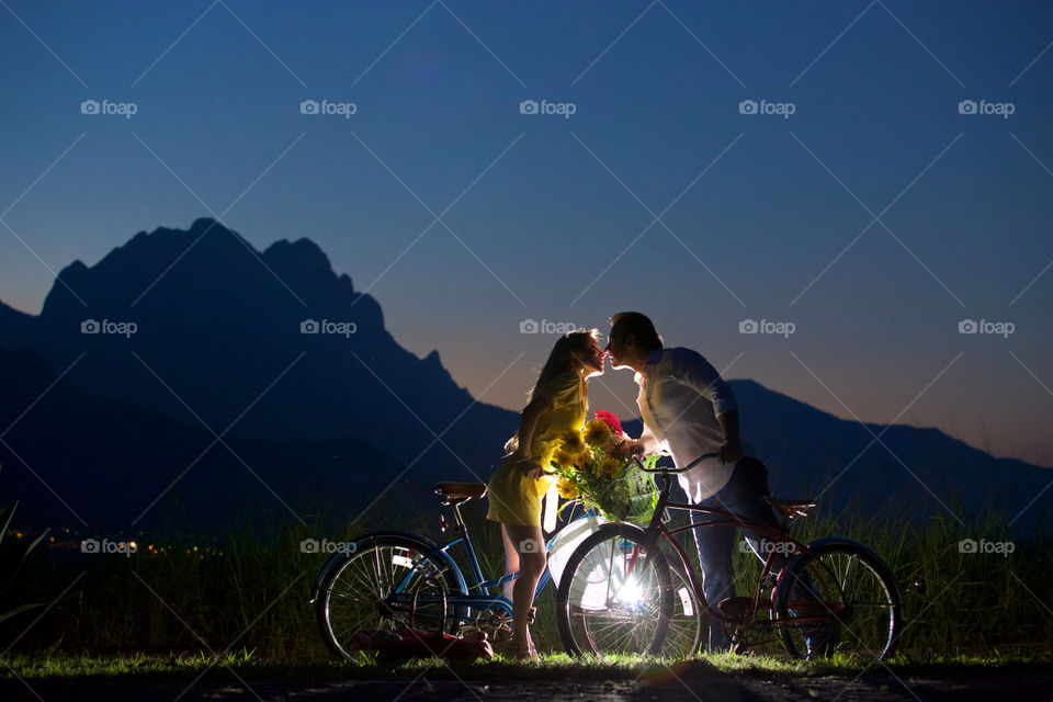 Couple kissing on a bike ride day. Bikes and couple kissing lovely