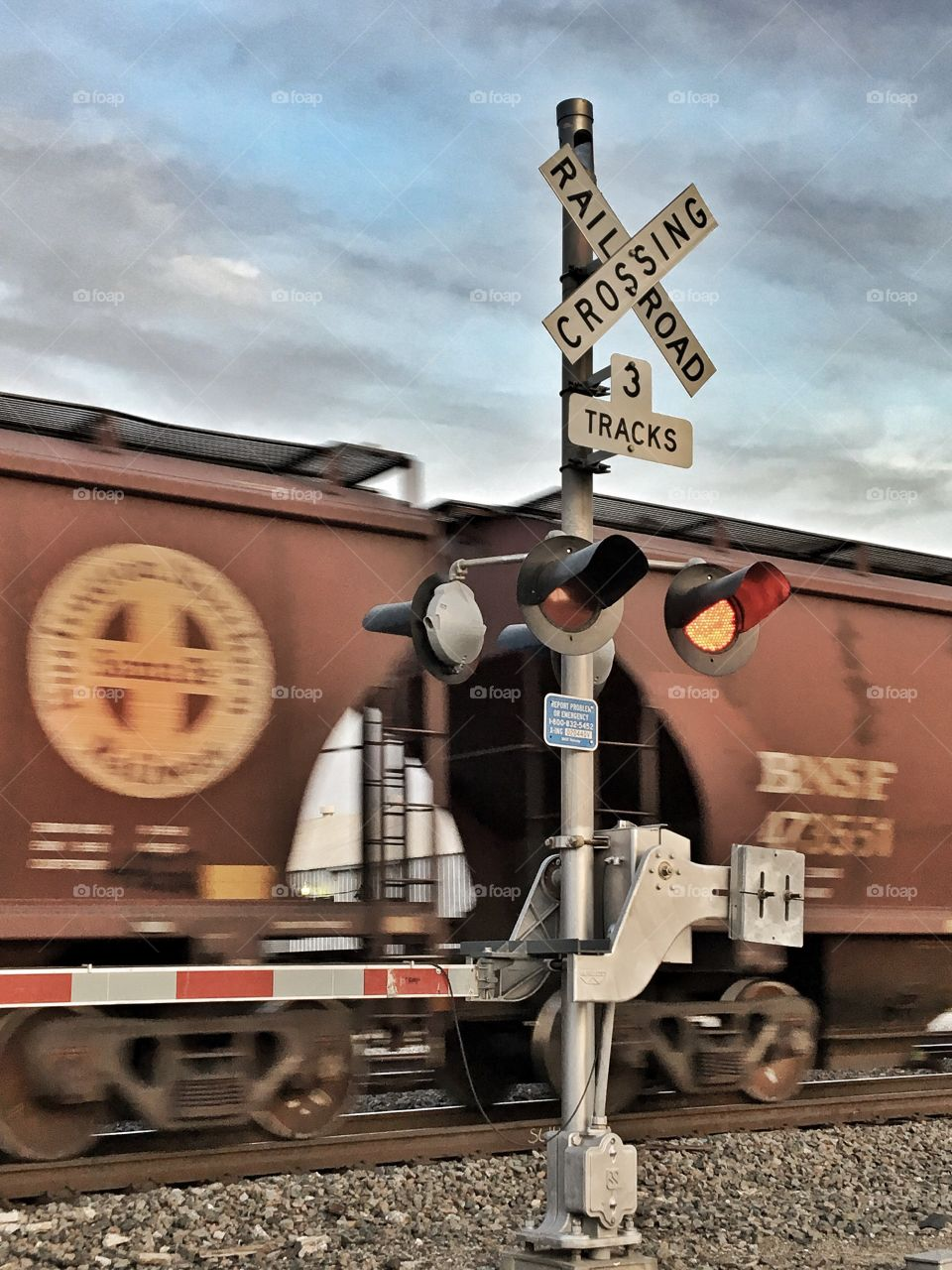 Railroad crossing and moving train.