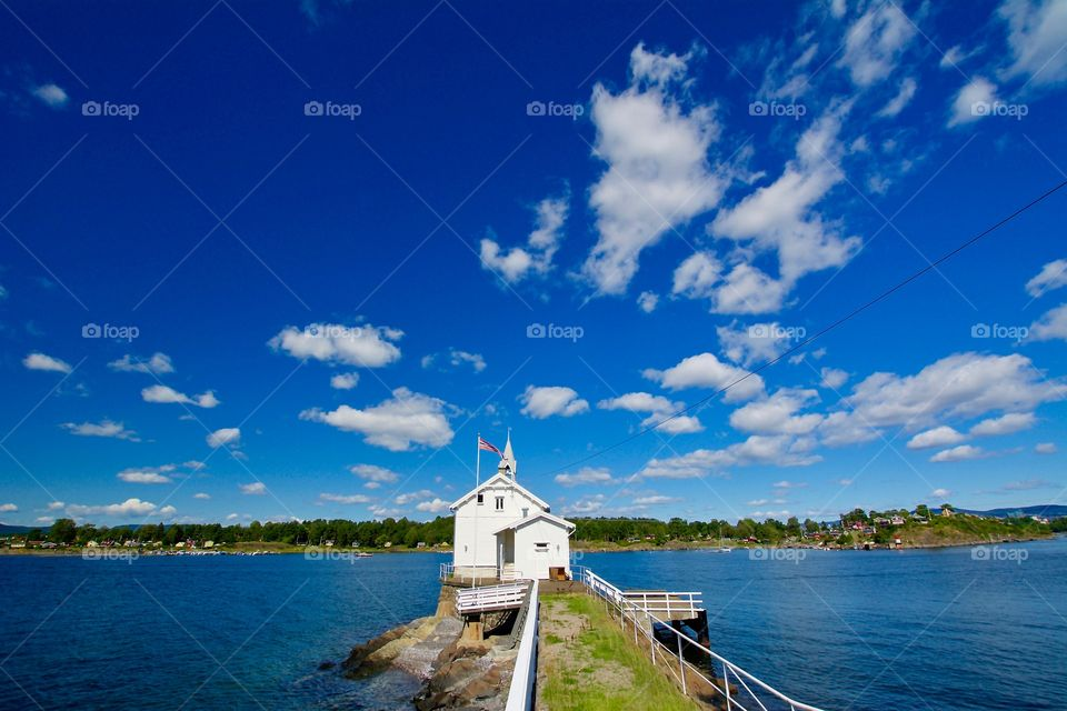 The stunning lighthouse at Gressholmen in Oslo in fair weather