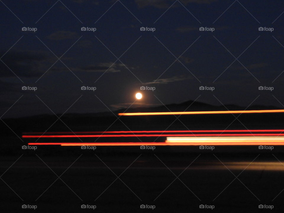 Moon rise by the highway