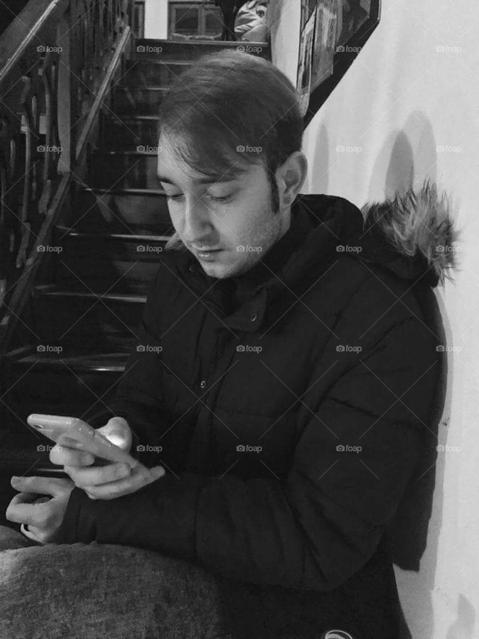 Boy using mobile phone.