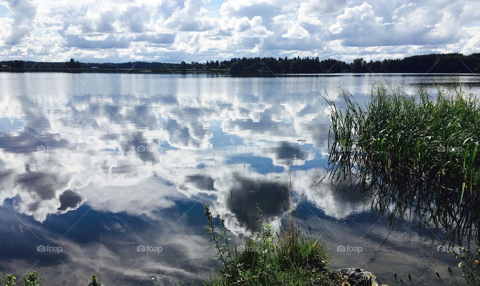 Water Reflection, Cloudy Sky in summer