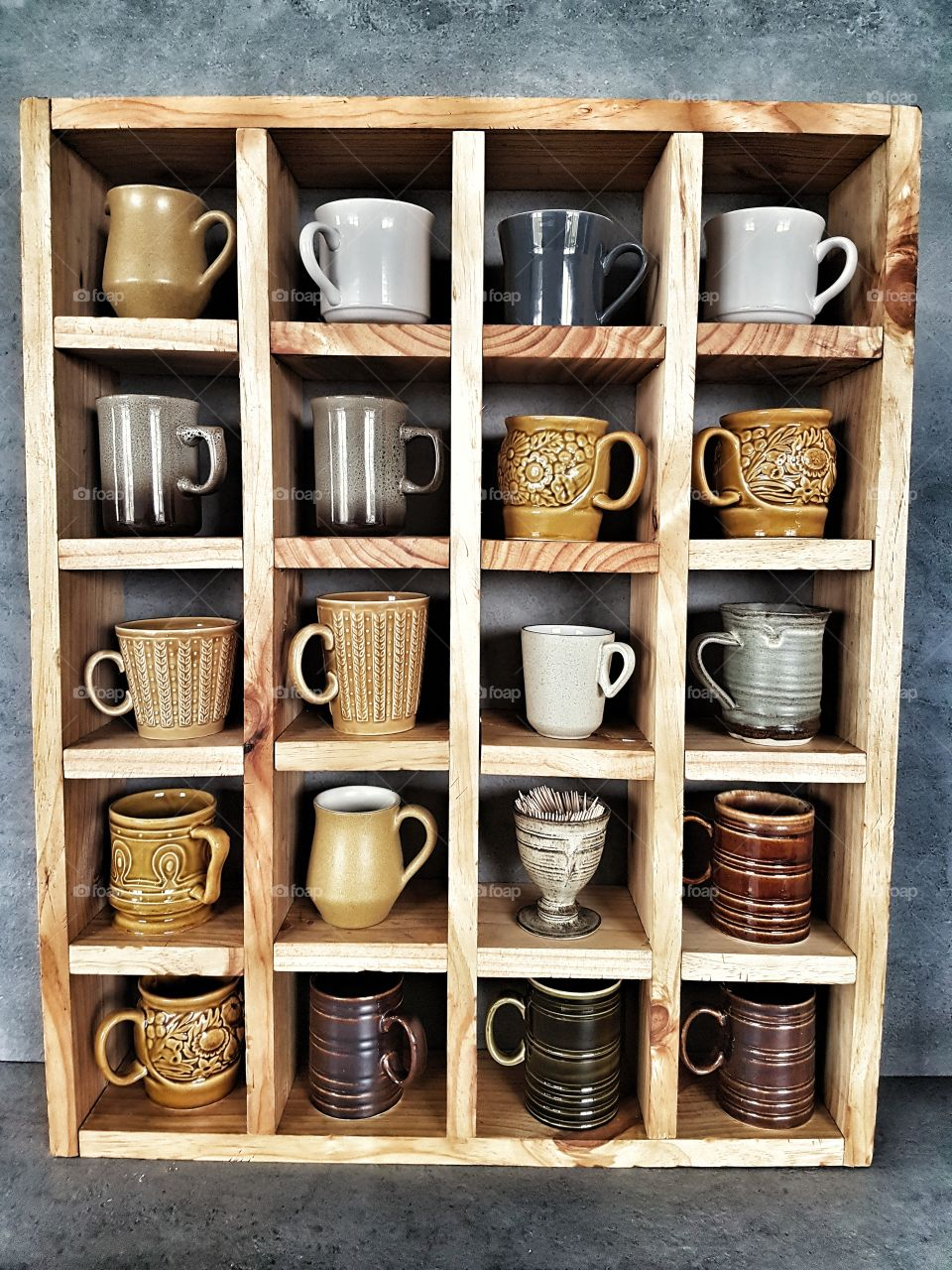 collection of vintage mugs and pottery on old rustic wooden shelf