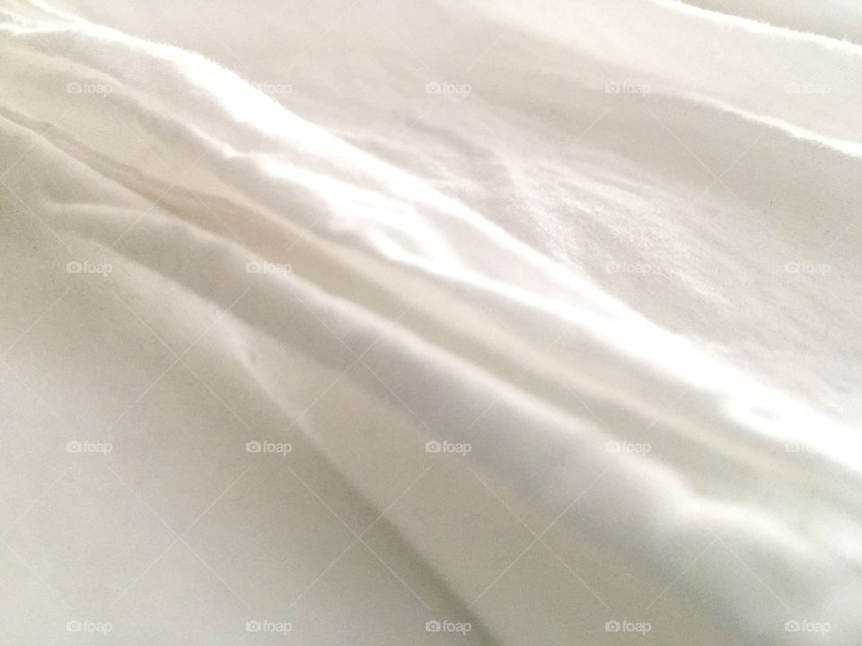 Close-up of organic white cotton sheets.
