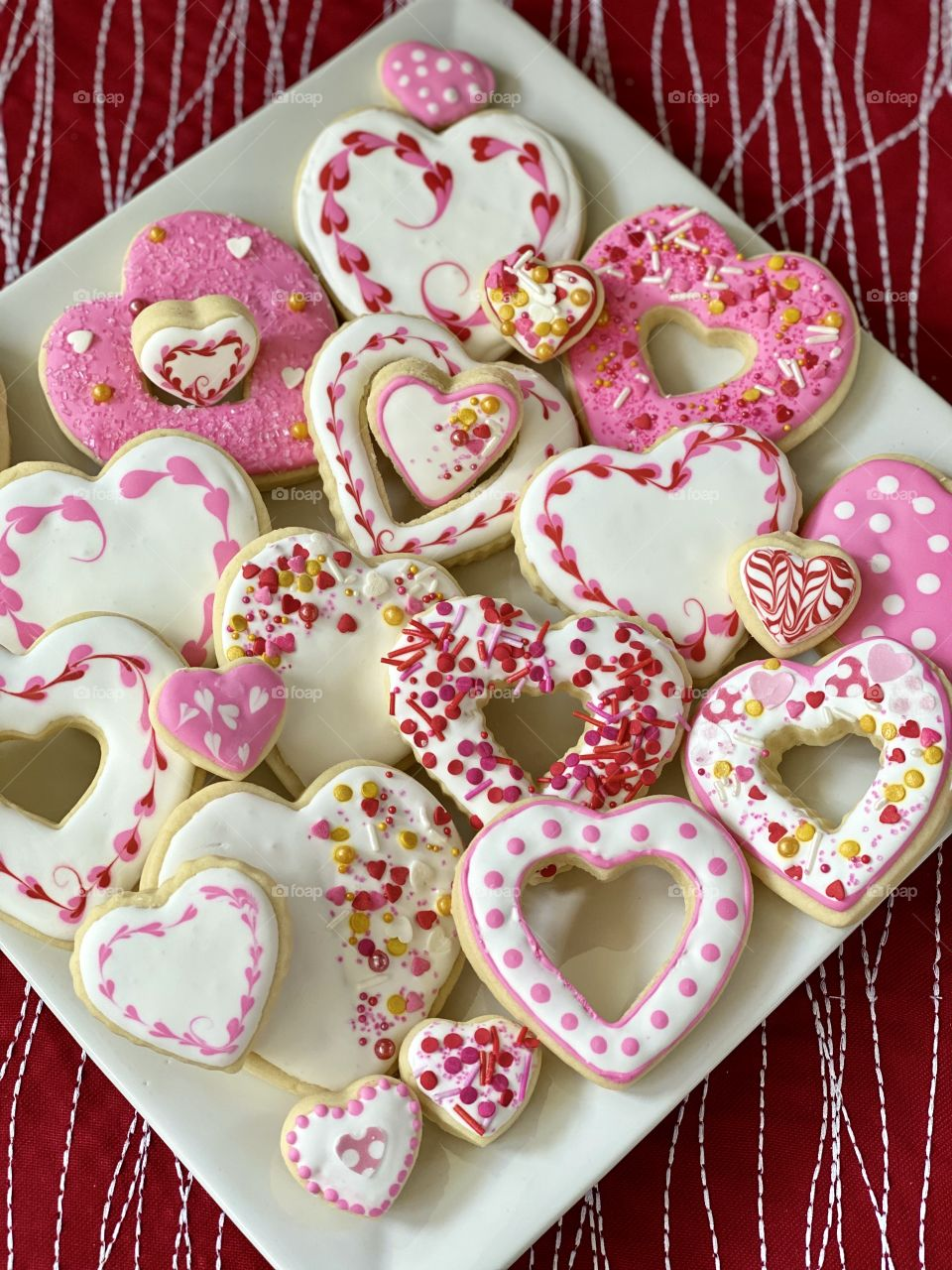 A beautiful plate of Valentine's Day cookies frosted with royal icing.