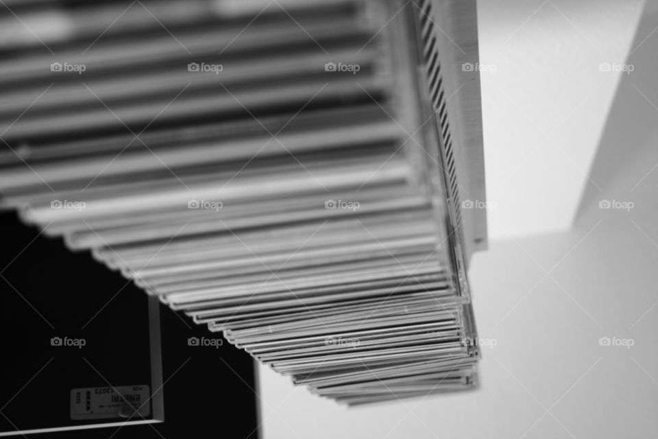 CD cases from above in black and white