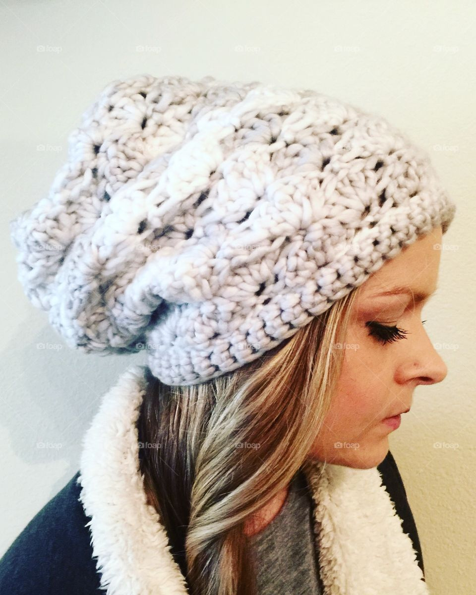 Young woman wearing knitted hat