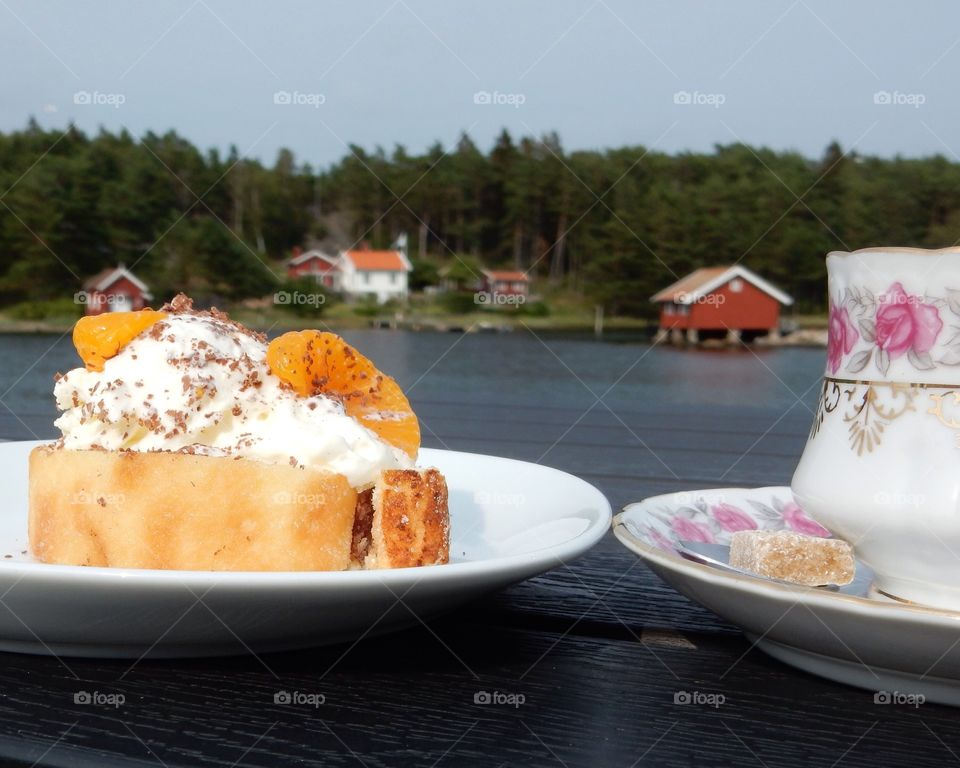 Cake and a cup of coffee. Coffee and cake by the sea