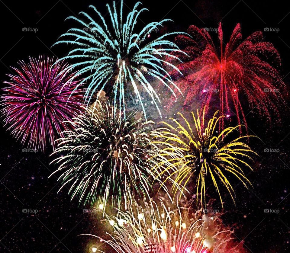 Dazzling multicolored fireworks bursting into the night sky.