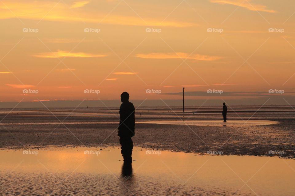 Another place. A photographers dream... A beautiful evening with the sun setting over the Anthony Gormley statues at Crosby beach