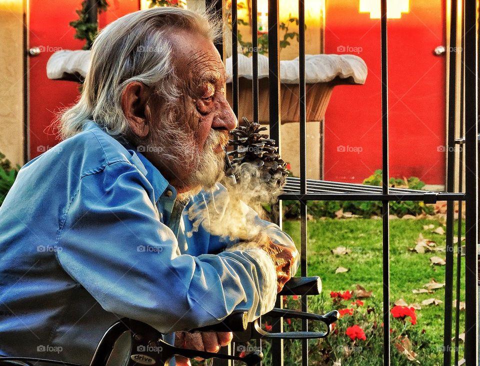 Old man smoking pipe