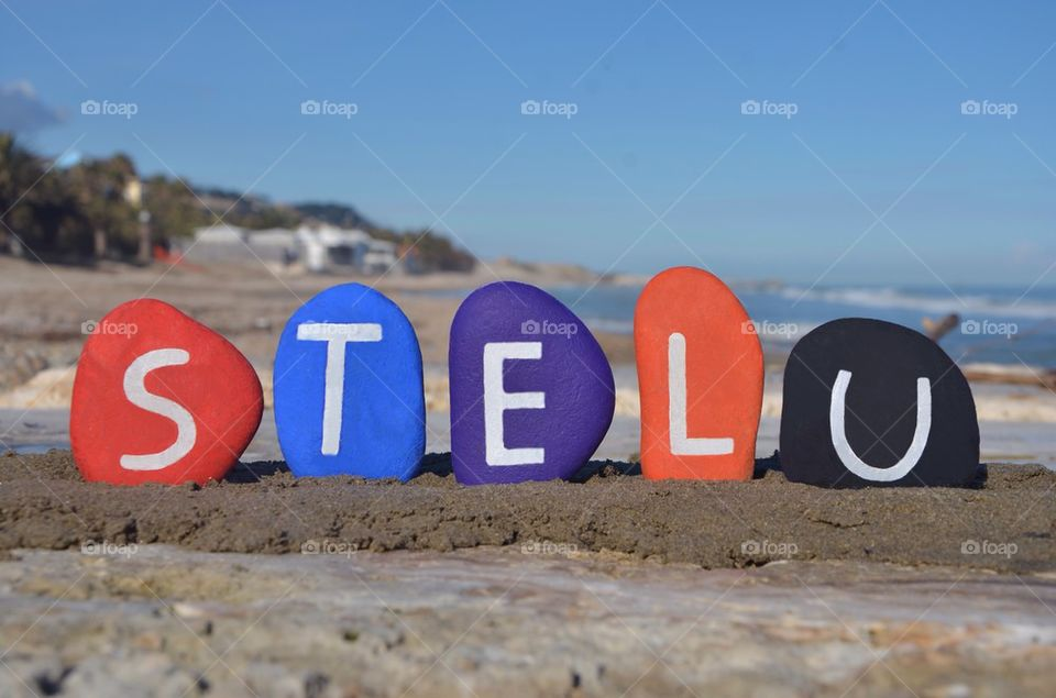 Stelu, romanian male name on colourful stones