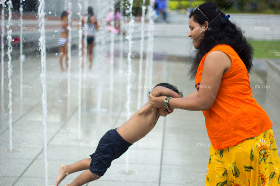 Savannah Mom and Son . Clicked this joyous pick of a mom playing with her shy and not willing to get wet son