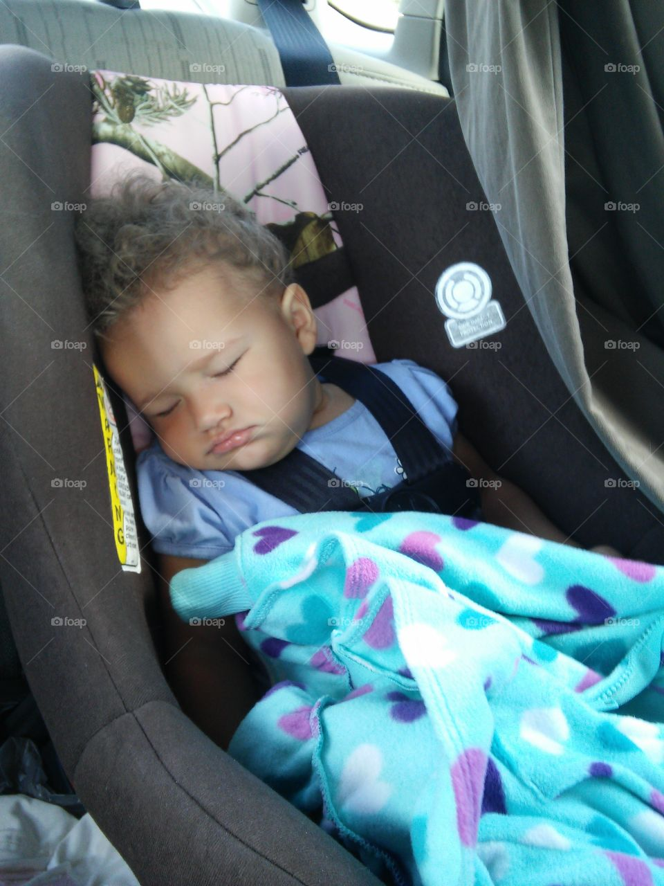 Tired baby sleeping. After a long day at the beach, 10 month old Tia fell asleep instantly on the drive home!!