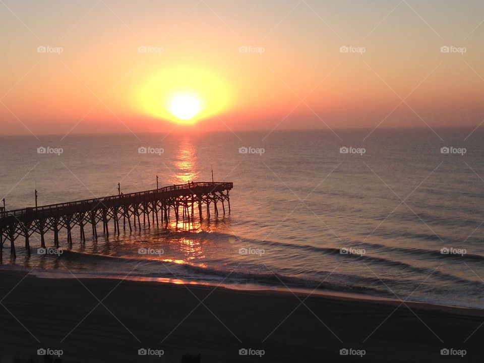 Delight. The is an awesome sunrise in Myrtle Beach South Carolina in the month of October.  Family and friend or your love one