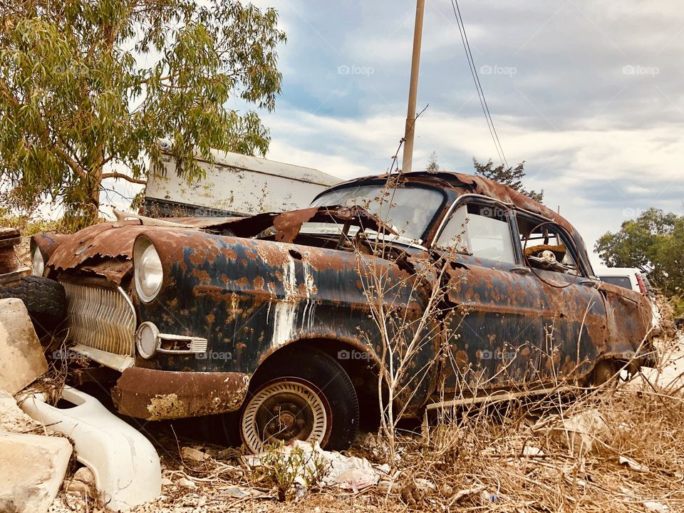 This is an abandoned vintage car, Opel. It has been abandoned for several years now. Pity for a beauty to be wrecked by rust