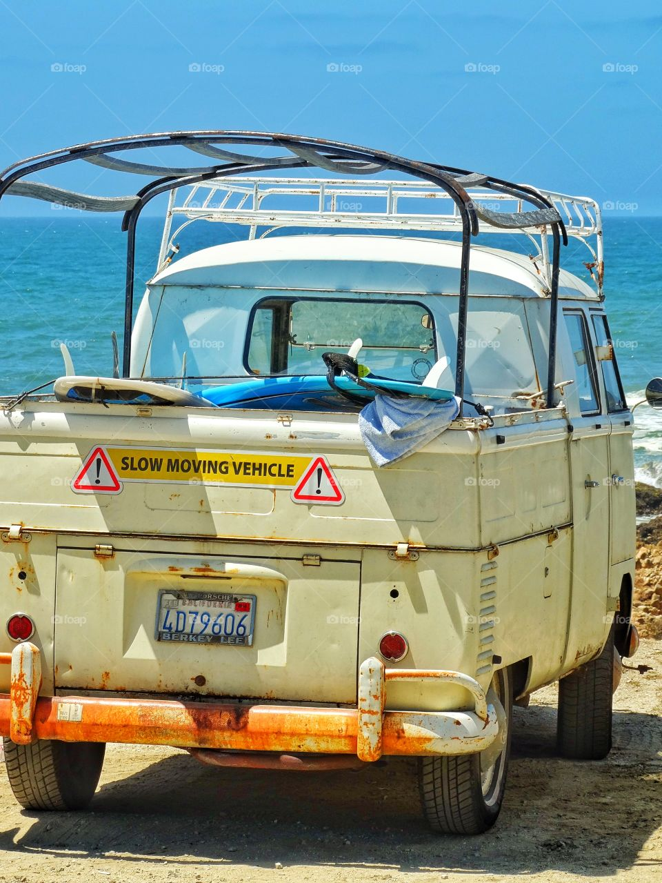 California Surfer Bus. Vintage VW Bus Loaded With Surfboards On The California Coast