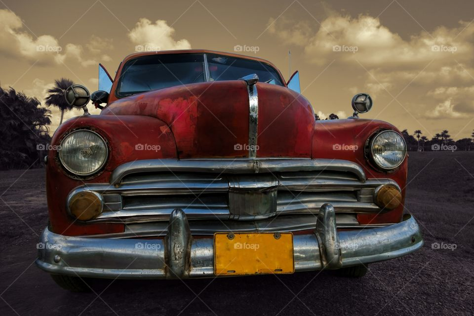 Classic American car in Cuba. A beautiful old Cuban car on a parking lot nearby Vinales, Cuba in tropical setting.