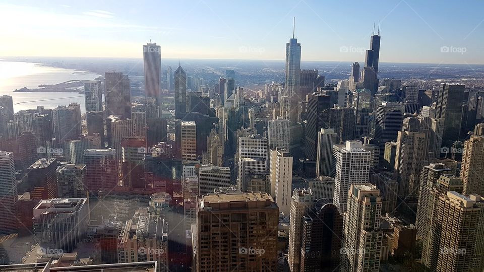 Chicago skyline panoramic day view from Willis Tower. Chicago City skyscrapers view inside observation floor at Sears Tower.