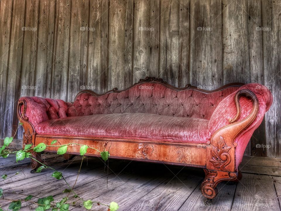Yesterday's Beauty Final Photo- Abandoned Victorian style couch on front porch of abandoned house😳