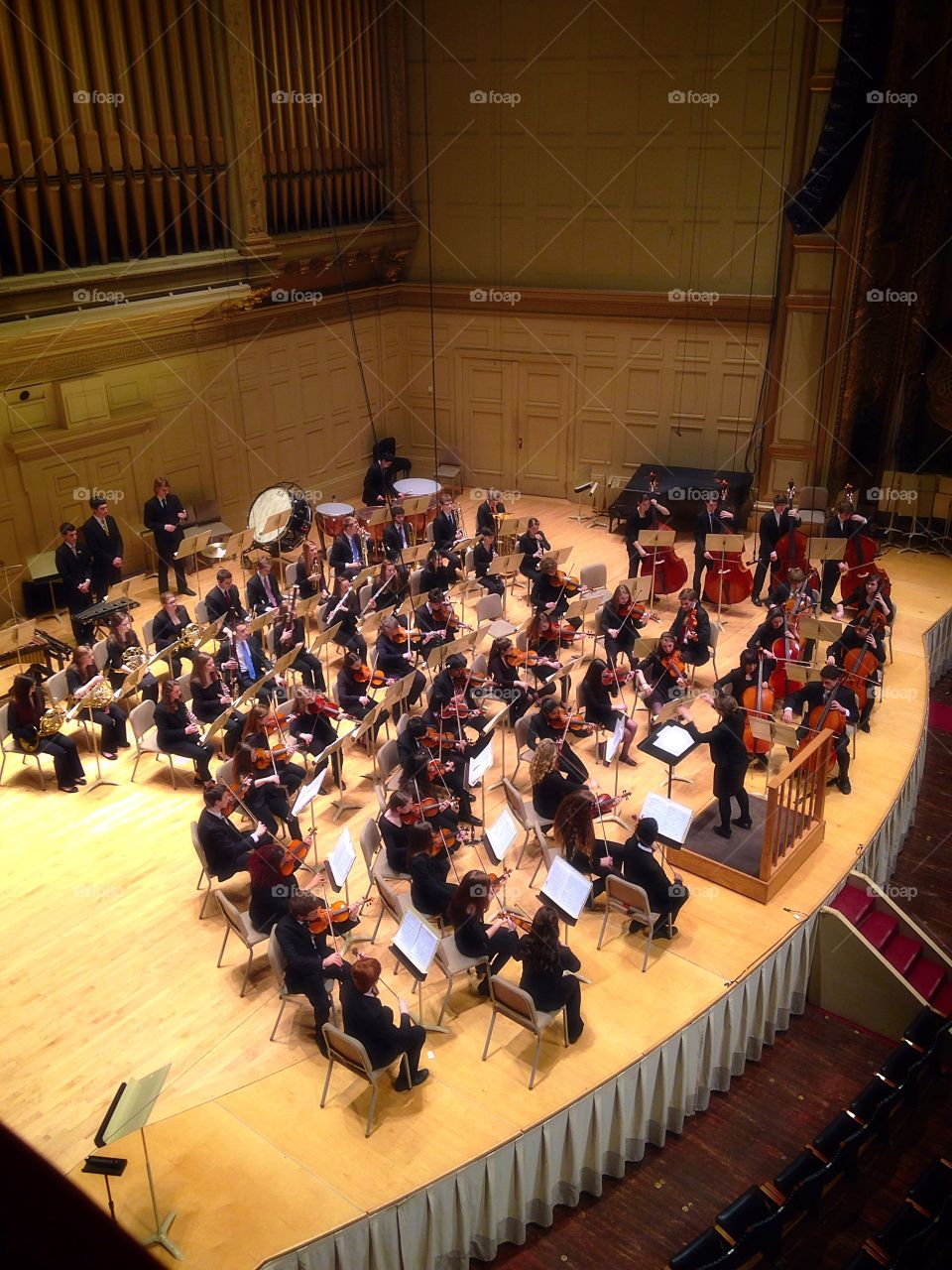 Orchestra . High school orchestra at Boston Symphony / musical instruments mission