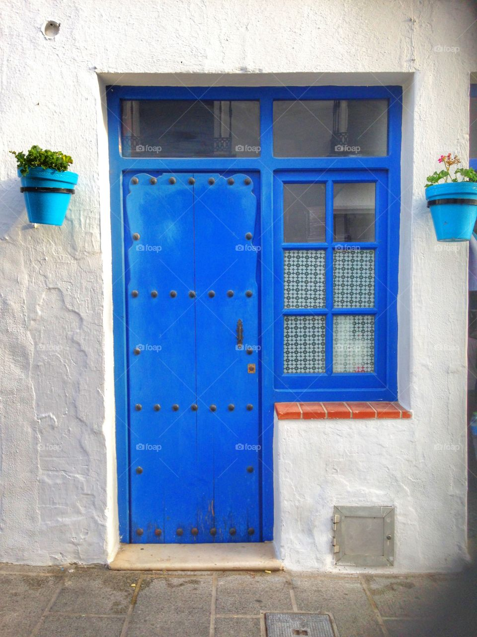 Closed door on blue house