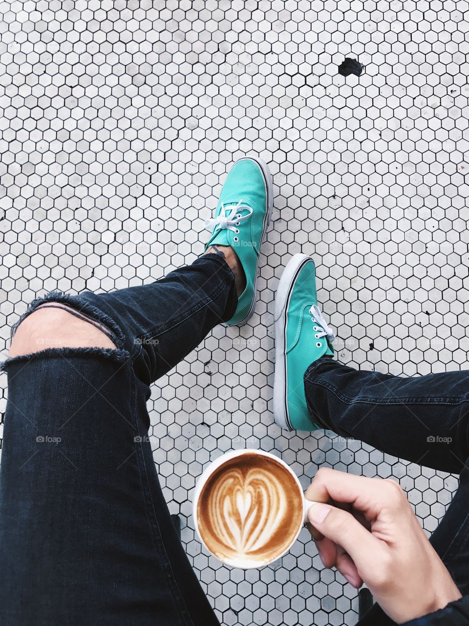 Coffee and feet on a cool tiled floor.