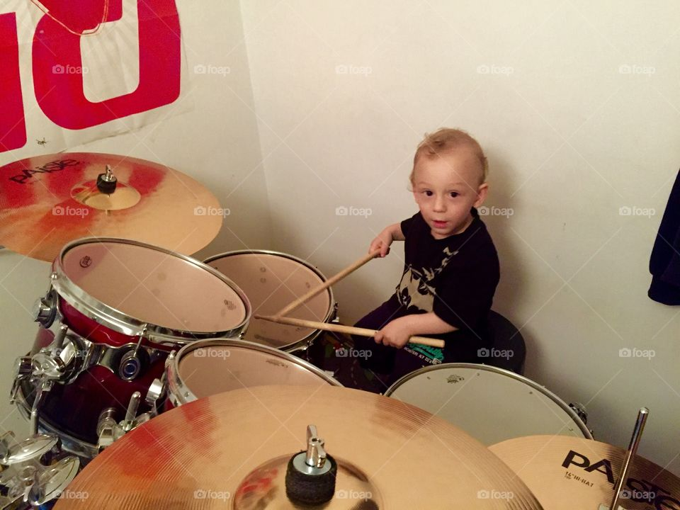 Small boy playing drums