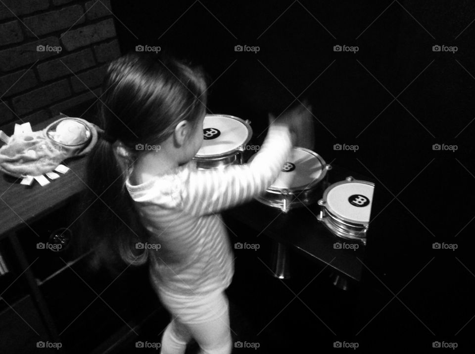 Hitsville USA. Little girl playing drums, at Detroit Kid City