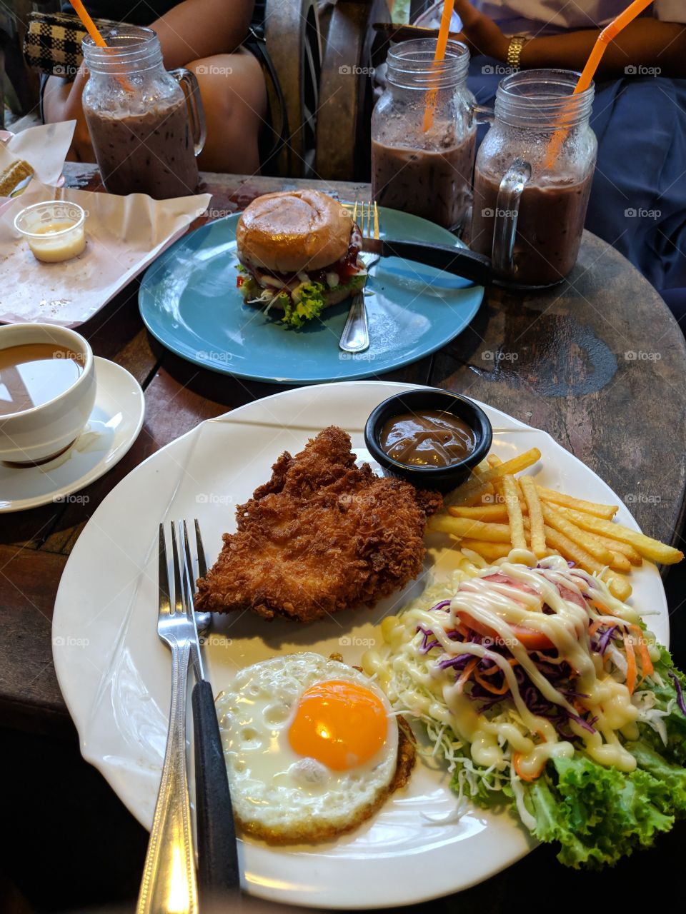 Fried Chicken Steak with egg and fries also salad
