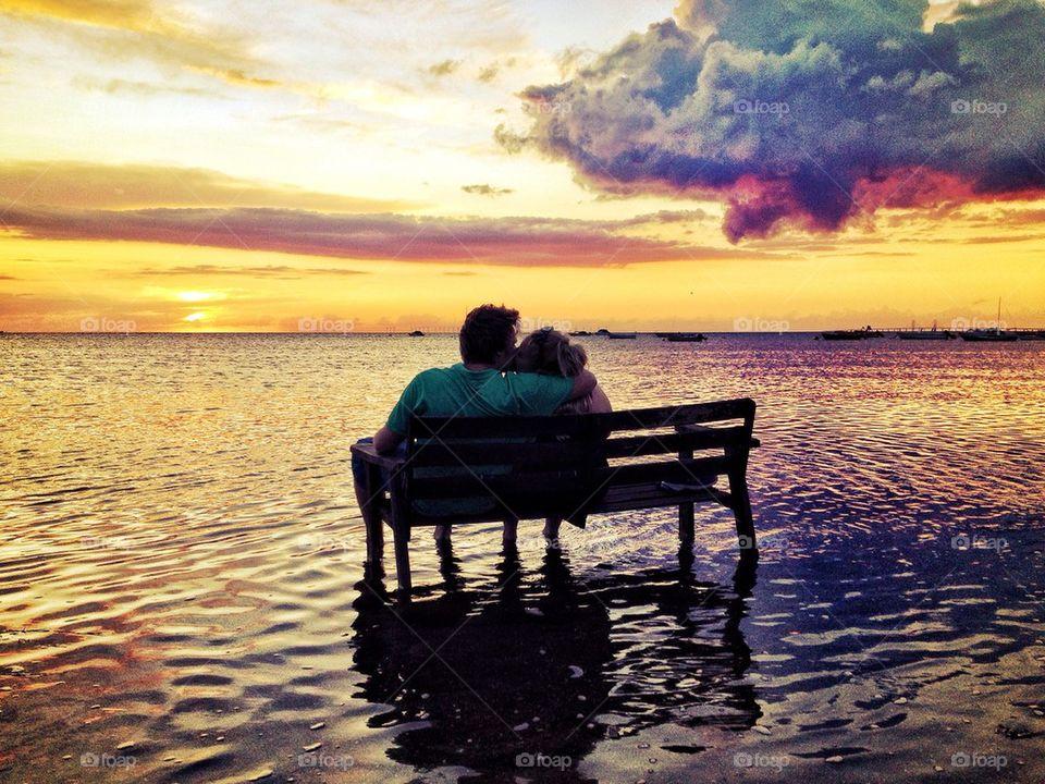 Loving couple enjoying sunset